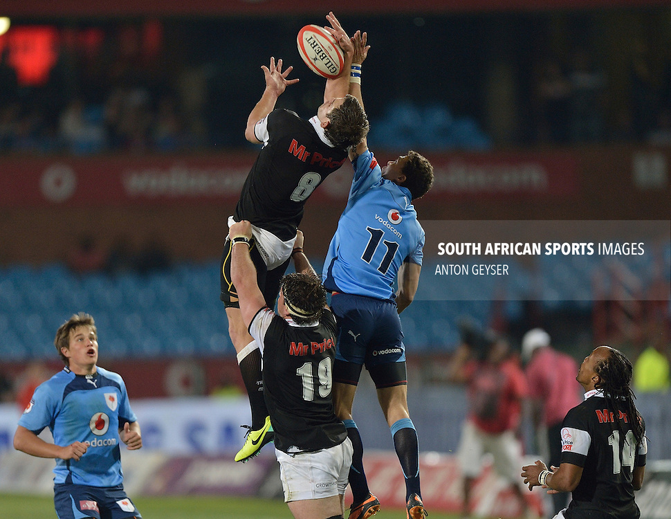 Keegan Daniel(C)  of the Sharks and Bjorn Basson of the Blue Bulls in acton during ABSA Currie Cup match between the Vodacom Bulls and the Mr Price Sharks played at Loftus Versfeld on Friday 04 October 2013 at 19:10.© Anton Geyser / Rugby 15 / SASPA