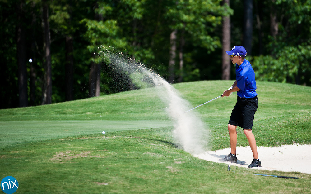 Cox Mill's Justin Westveer hits a shot out of the sand during the South Piedmont Conference Championship at the Piney Point Golf Club in Norwood. (Photo by James Nix)