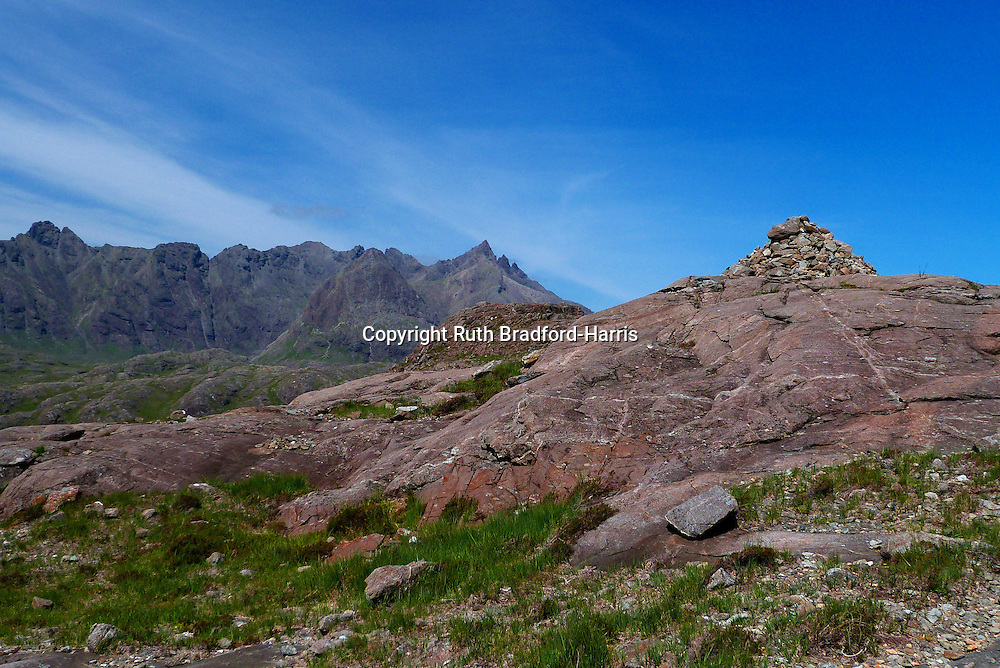 The spectacularly rugged northern-most end of Skye's Gabbro Cuillin Ridge, culminating with Sgurr nan Gillean and its Pinnacle Ridge, with Sgurr na h-Uamnha &amp; Sgurr Beag immediately in front of it.<br /> <br /> This photograph was taken from the summit cairns of the glacially-sculpted ridge of Druim Hain (Druim an Eidhne), whose fabulously laminated Bytownite Gabbro (Eucrite), spherulitic Rhyolite and intrusion breccias have excited geologists for generations.<br /> <br /> Date Taken: 18 June 2016.