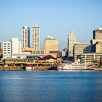 Picture of Peoria skyline with downtown city buildings along the Illinois River and the Spirit of Peoria riverboat.