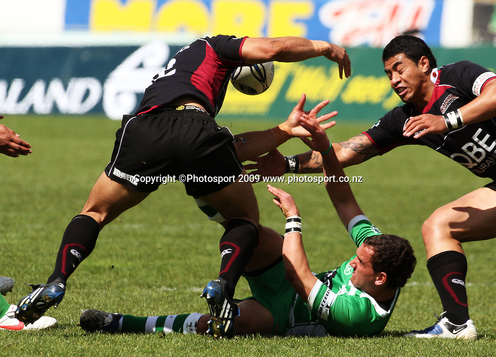 Harbour's Andrew Mailei and George Pisi steal the ball from Aaron Cruden in the build-up to Rudi Wulf's try.<br /> Air NZ Cup rugby - Manawatu Turbos v North Harbour at FMG Stadium, Palmerston North, New Zealand. Saturday, 24 October 2009. Photo: Dave Lintott/PHOTOSPORT