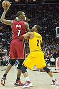 CLEVELAND, OH - MARCH 20: Chris Bosh #1 of the Miami Heat looks to pass while under pressure from Wayne Ellington #21 of the Cleveland Cavaliers during the first half at Quicken Loans Arena on March 20, 2013 in Cleveland, Ohio. NOTE TO USER: User expressly acknowledges and agrees that, by downloading and or using this photograph, User is consenting to the terms and conditions of the Getty Images License Agreement. (Photo by Jason Miller/Getty Images)  *** Local Caption *** Chris Bosh; Wayne Ellington