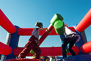 Aero Merchant, left, and Payge Diayand, right, battle in the inflaitable duel ring during the Paw Paw Festival in Albany, Ohio on September 14, 2013.