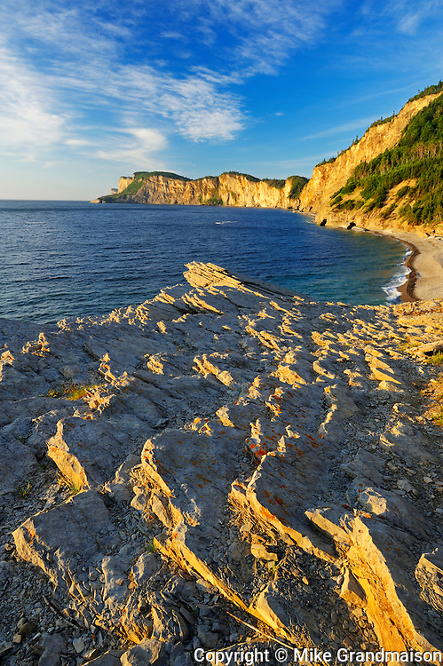 Limestone along the Atlantic shoreline at sunrise<br /> Forillon National Park<br /> Quebec<br /> Canada