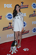 Actress Olivia Munn and friend arrive at the All-Star Dog Rescue Celebration at Barker Hangar on November 21, 2015 in Santa Monica, California (Photo: Charlie Steffens)