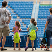 August 16, 2014, New Haven, CT:<br /> A family looks at Stadium Court during Kids Day on day three of the 2014 Connecticut Open at the Yale University Tennis Center in New Haven, Connecticut Sunday, August 17, 2014.<br /> (Photo by Billie Weiss/Connecticut Open)