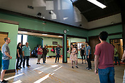 Jumptown Swing introductory class warms up at the Wil-Mar Neighborhood Center in Madison, Wisconsin, Thursday, May 23, 2019.