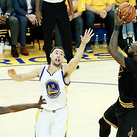 12 June 2017: Cleveland Cavaliers forward LeBron James (23) takes a jump shot over Golden State Warriors guard Klay Thompson (11) during the Golden State Warriors 129-120 victory over the Cleveland Cavaliers, in game 5 of the 2017 NBA Finals, at the Oracle Arena, Oakland, California, USA.