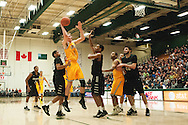 Catamounts forward Zach McRoberts (1) leaps to take a shot during the men's basketball game between the Binghamton Bearcats and the Vermont Catamounts at Patrick Gym on Monday night January 19, 2015 in Burlington, Vermont. (BRIAN JENKINS, for the Free Press)