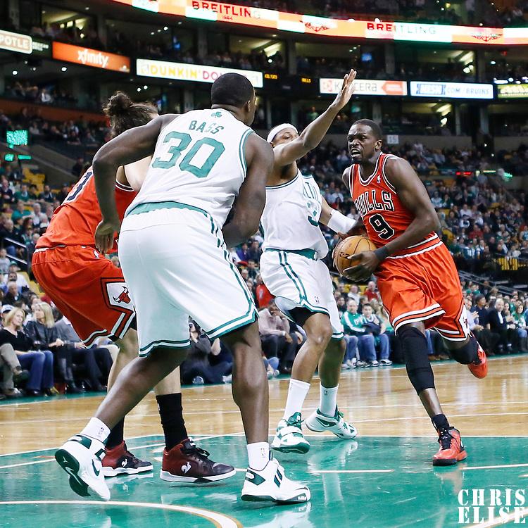 13 February 2013: Chicago Bulls small forward Luol Deng (9) drives past Boston Celtics small forward Paul Pierce (34) during the Boston Celtics 71-69 victory over the Chicago Bulls at the TD Garden, Boston, Massachusetts, USA.