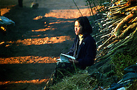BURMA (MYANMAR), Shan State, Peinnebin. 2006. Just after sunrise, even on the wedding day, hard-working Palaung students can be heard singing their homework. A musical framework aids memory.