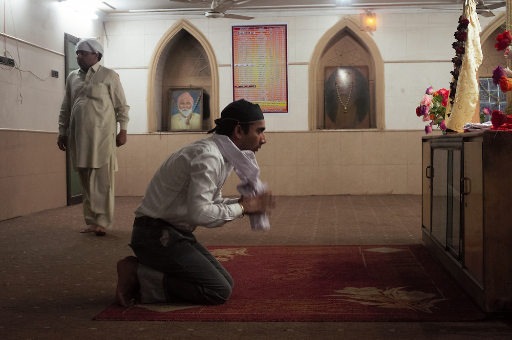 Ajeet Kumar, a 22 year old Hindu business student prays at Gurdwar Hindu temple, Sukkur, Sindh, Pakistan on March 22, 2012. A rise in in reports of forced conversion of Hindu girls to Islam in provinces in Pakistan has gained prominence within the political, media, religious and social domains with the case of a 21 year old woman Rinkle Kumari. On February 24, 2012 her family reported to police of Ghotki district, Sindh province that she had been abducted by armed men from the family home in the village of Mirpur Mathelo. it is then alleged by the family and broadrer hindu community that she was forced to convert to Islam and marry Syed Naveed Shah, a neighbour of the girl within their village. Complications with court hearings for the case, perceptions by the Muslim community that the police sided with the Muslim community when dealing with issue and the politicisation of the case by a Pakistan Peoples Party Member for National Assembly Mian Abdul Haq alias Mian Mitho has led to a hearing being called in the Supreme Court, Islamabad, Pakistan on March 26, 2012. The hearing will hopefully ascertain whether the girl was abducted or in fact left with Syed Naveed Shah of her own free will.