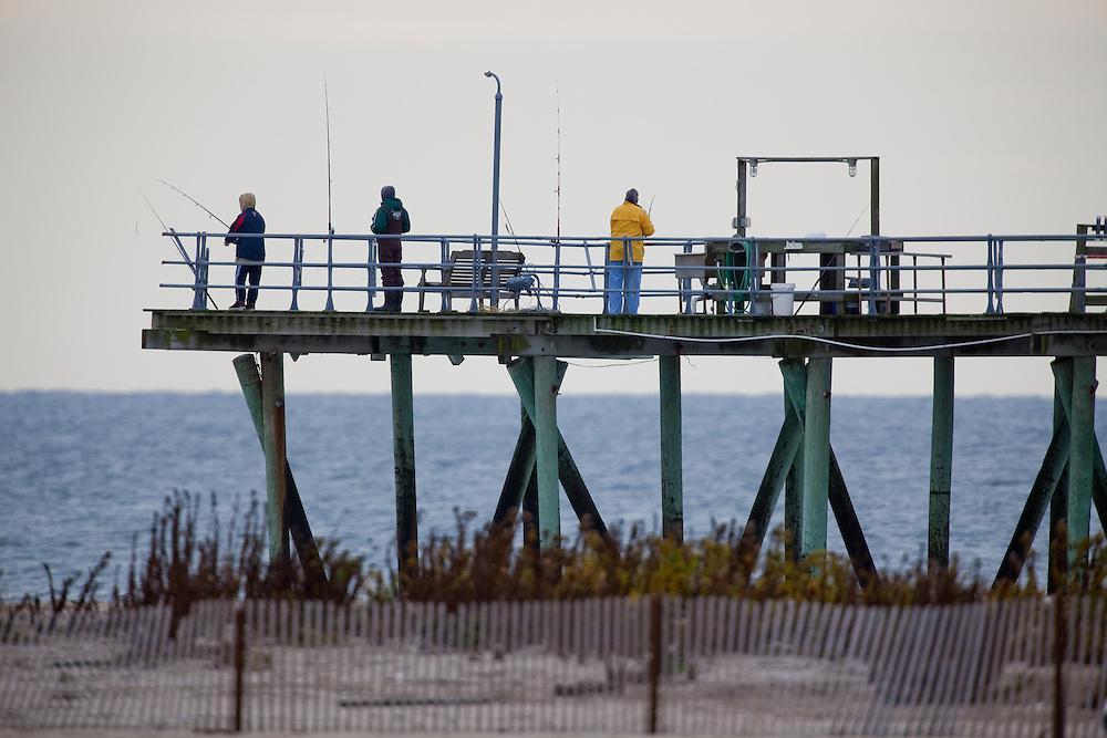 Fisherman on the Belmar Fishing Club pier.  The club itself is  on the beach side of the boardwalk near Shark River Inlet