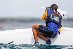 World Sailing Emerging Nations Program - Boca Chica Sailing Club, Santo Domingo 08/19/2017 - DAY 2 - Delyth Morris from Barbados pulls her reversed boat keel, in action during the regatta