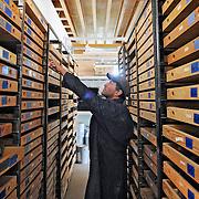 Ian Stewart/Yukon News<br /> Johann Slam examines the stacks at the H.S. Bostock Core Library.