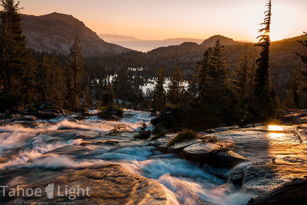 Upper Velma Lake and Lake Tahoe at sunrise as seen from Fontanelles lake in Desolation Wilderness.