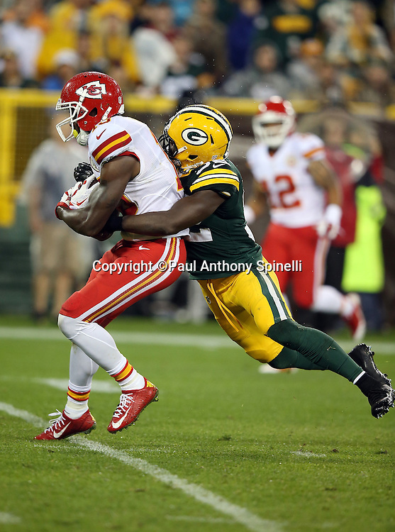 Kansas City Chiefs wide receiver Jeremy Maclin (19) is tackled by Green Bay Packers strong safety Chris Banjo (32) as he catches and runs with a 31 yard pass reception for a first down and goal to go at the 7 yard line in the third quarter during the 2015 NFL week 3 regular season football game against the Green Bay Packers on Monday, Sept. 28, 2015 in Green Bay, Wis. The Packers won the game 38-28. (©Paul Anthony Spinelli)
