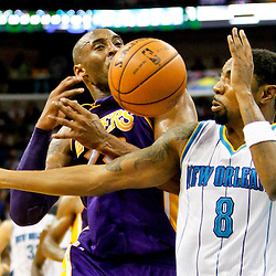 Dec 5, 2012; New Orleans, LA, USA; Los Angeles Lakers shooting guard Kobe Bryant (24) loses the ball as New Orleans Hornets shooting guard Roger Mason Jr. (8) defends during the first half of a game at the New Orleans Arena.  Mandatory Credit: Derick E. Hingle-USA TODAY Sports