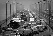 Traffic is backed up on a bridge leading in to central Chongqing.