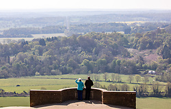 © Licensed to London News Pictures. 15/04/2020. London, UK. Two walkers on top of Box Hill a beauty spot in the Surrey Hills which has been closed to traffic since the lockdown due to the coronavirus pandemic as Ministers decide when and how the lockdown will finish as politicians are warned that the UK could face the worst recession in 300 years. Photo credit: Alex Lentati/LNP