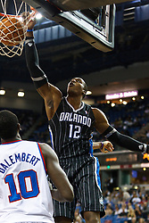 March 9, 2011; Sacramento, CA, USA;  Orlando Magic center Dwight Howard (12) dunks in front of Sacramento Kings center Samuel Dalembert (10) during the first quarter at the Power Balance Pavilion.