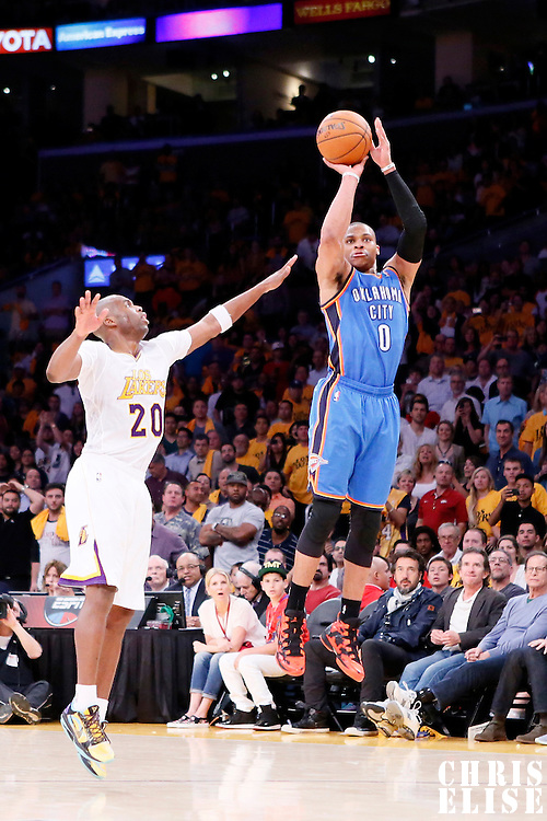 09 March 2014: Oklahoma City Thunder point guard Russell Westbrook (0) takes a three point jumpshot over Los Angeles Lakers shooting guard Jodie Meeks (20) during the Los Angeles Lakers 114-110 victory over the Oklahoma City Thunder at the Staples Center, Los Angeles, California, USA.