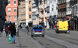 "THEMENBILD - Eine Polizeistreife herrengasse in Graz in Folge des Coronavirus-Ausbruchs in Österreich, aufgenommen am 16.03.2020 in Graz, Österreich // A police car in the ""Herrengasse"" as a result of the coronavirus outbreak in Austria, on 2020/03/16 in Graz, Austria. EXPA Pictures © 2020, PhotoCredit: EXPA/ Erwin Scheriau"