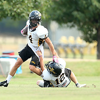 Itawamba AHS wide receiver Lane Domino tries to break free from a tackle during practice on Friday afternoon in Fulton.