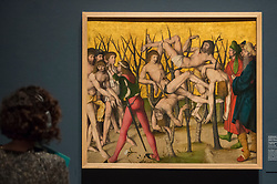 "© Licensed to London News Pictures. 28/02/2019. LONDON, UK. A staff member views ""The Martyrdom of the Ten Thousand"" c1508-09 by Workshop of Hans Leu the Elder. Preview of ""The Renaissance Nude"", an exhibition at the Royal Academy of Arts in Piccadilly of 90 works examining the emergence of the nude in European art.  Works by artists including Leonardo da Vinci to Michelangelo are on display in the Sackler Galleries 3 March to 2 June 2019.  Photo credit: Stephen Chung/LNP"