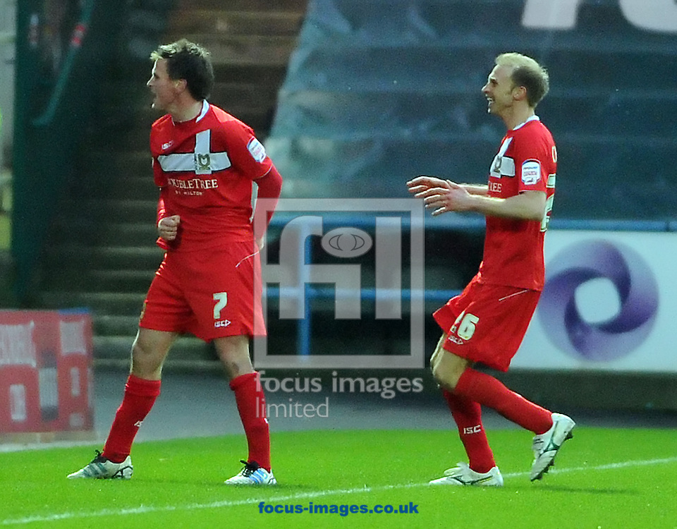 Picture by Graham Crowther/Focus Images Ltd. 07763140036.04/02/12.Stephen Gleeson  of MK Dons celebrates scoring agains Huddersfield  during the Npower League 1 game at The Galpharm Stadium Stadium, Huddersfield.