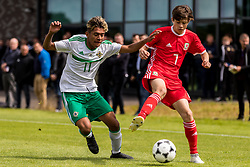 WREXHAM, WALES - Thursday, August 15, 2019: Wales' Calum Agius and Northern Ireland's Kenny Ximines during the UEFA Under-15's Development Tournament match between Wales and Northern Ireland at Colliers Park. (Pic by Paul Greenwood/Propaganda)