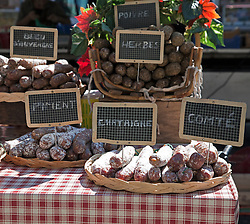 Sausage in a variety of disguises are hot sellers at the local public markets throughout Provence.  Thursdays are market day in Villeneuve lez  <br /> Avignon, an interesting small town across the Rhone River from Avignon.  Easily accessed by city bus, the market offers the freshest of locally grown foods, along with a wide variety of crafts and clothing, a good stop for regional souvenirs.