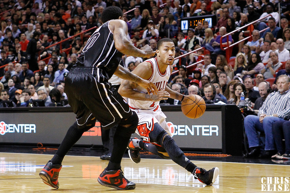 29 January 2012: Chicago Bulls point guard Derrick Rose (1) drives past Miami Heat power forward Udonis Haslem (40) during the Miami Heat 97-93 victory over the Chicago Bulls at the AmericanAirlines Arena, Miami, Florida, USA.