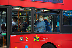 © Licensed to London News Pictures. 18/05/2020. London, UK. A woman wearing a face mask travelling on a bus in north London. Passengers travelling on public transport are are asked to wear a face covering. Photo credit: Dinendra Haria/LNP