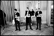 Wine Waiters at a wedding reception. Hyde Park Hotel. 16 December 1984. Film 841121f35<br /> &copy; Copyright Photograph by Dafydd Jones<br /> 66 Stockwell Park Rd. London SW9 0DA<br /> Tel 0171 733 0108