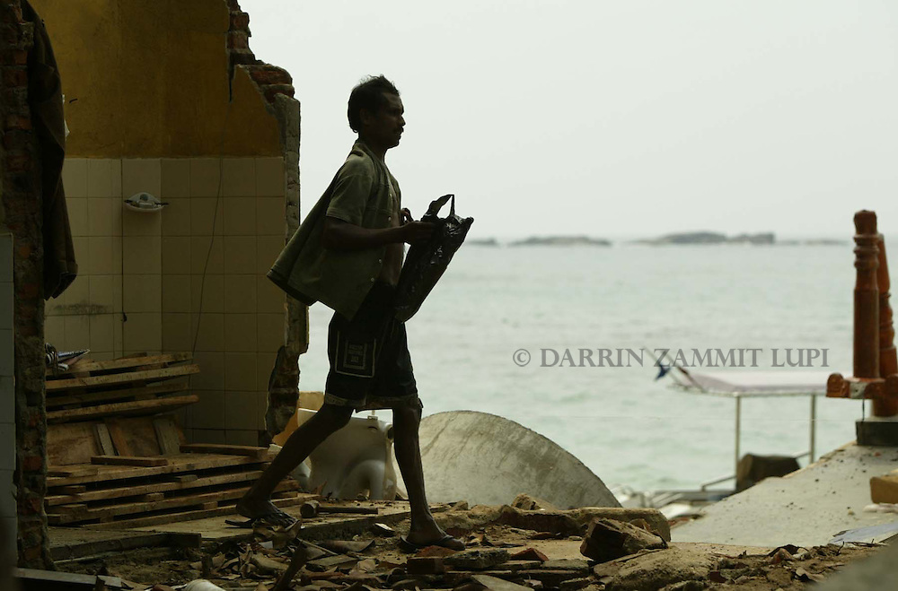 A man walks through the ruins of houses in the tsunami-devastated town of Galle on the south-west coast of Sri Lanka on January 13, 2005..Photo by Darrin Zammit Lupi