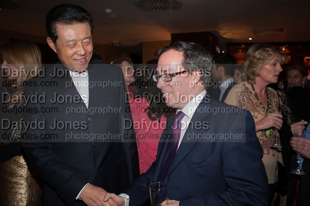 THE CHINESE AMBASSADOR; EDWARD LLEWELLYN, Chinese New Year dinner given by Sir David Tang. China Tang. Park Lane. London. 4 February 2013.