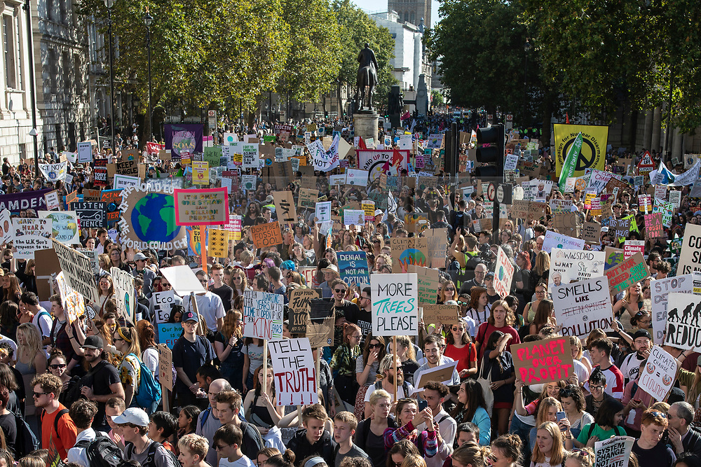 © Licensed to London News Pictures. 20/09/2019. London, UK. Tens of thousands march along Whitehall as part of the Global Climate Strike in London. Protests about the climate crisis are being led by young people in cities around the world, with millions expected to attend. Photo credit: Rob Pinney/LNP