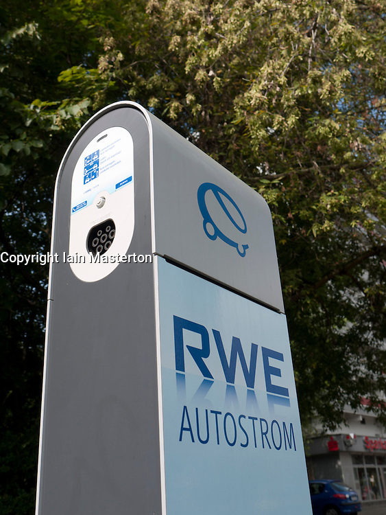 New electric car plug-in recharging station operated by RWE on Berlin street Germany