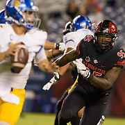 21 October 2016: The San Diego State Aztecs football team takes on the San Jose State Spartans Friday night at Qualcomm Stadium. San Diego State defensive linemen Noble Hall (95) rushes the San Jose quarterback in the fourth quarter. The Aztecs beat the Spartans 42-3 to extend there home win streak. www.sdsuaztecphotos.com