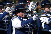 Participants from a high school marching band march in the Veterans Day Parade, which honors American military veterans, in Tucson, Arizona, USA.