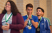 Students receive championship medals during the 2015-2016 Vocablary Bowl Trophy presentation at Chavez High School, May 9, 2016.