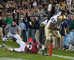 November 28, 2009; Stanford, CA, USA;  Notre Dame Fighting Irish wide receiver Golden Tate (23) beats Stanford Cardinal cornerback Johnson Bademosi (27) for a touchdown during the first quarter at Stanford Stadium.  Stanford defeated Notre Dame 45-38.
