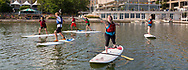 Students practice yoga on stand-up paddle boards on Lake Mendota.  Rentals and classes are available at Outdoor UW, located in Memorial Union, in 2014.