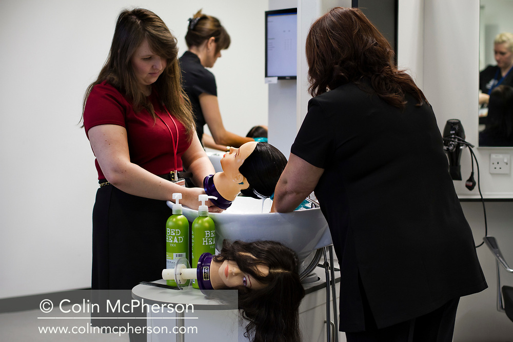Word: MODELLING<br /> <br /> Caption: Members of staff at the hair salon washing mannequin heads prior to the application of a conditioner.<br /> <br /> The image is taken from a project entitled 'The Proof Principle' by photographer Colin McPherson, which was commissioned in 2011 by Unilever to celebrate 100 years of work at the company's research and development facility at Port Sunlight, Wirral.<br /> <br /> All images © Colin McPherson, all rights reserved.