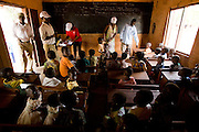 Health workers and volunteers prepare to vaccinate children during a national polio immunization exercise at the Moglaa primary school in the town of Moglaa, northern Ghana on Friday March 27, 2009.