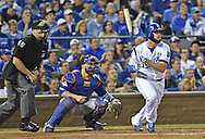 Oct 23, 2015; Kansas City, MO, USA; Kansas City Royals third baseman Mike Moustakas (8) hits a solo home run against the Toronto Blue Jays in the second inning in game six of the ALCS at Kauffman Stadium. Mandatory Credit: Peter G. Aiken-USA TODAY Sports