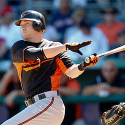 March 7, 2011; Fort Myers, FL, USA; Baltimore Orioles left fielder Nolan Reimold (14) during a spring training exhibition game against the Boston Red Sox at City of Palms Park.   Mandatory Credit: Derick E. Hingle