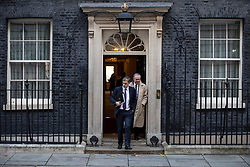 © Licensed to London News Pictures. 13/11/2018. London, UK. Conservative Chief Whip Julian Smith (L) and Attorney General Geoffrey Cox QC (R) leave 10 Downing Street after the Cabinet meeting. Photo credit: Rob Pinney/LNP