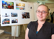 Darcy Holdorf displays her photo story about African immigrants in China at the Student Expo.